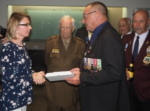gaelle-caresmel-french-representative-being-presented-an-rsl-plaque-by-brian-tidyman-president-of-the-hervey-bay-rsl-sub-branch-with-jim-wilson-and-jukka-mantari