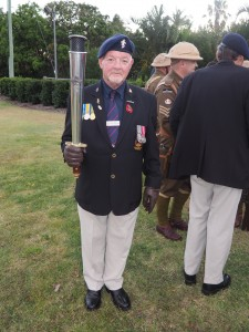 toby-tidyman-vice-prsident-hervey-bay-rsl-sub-branch-with-the-rsl-anzac-flame
